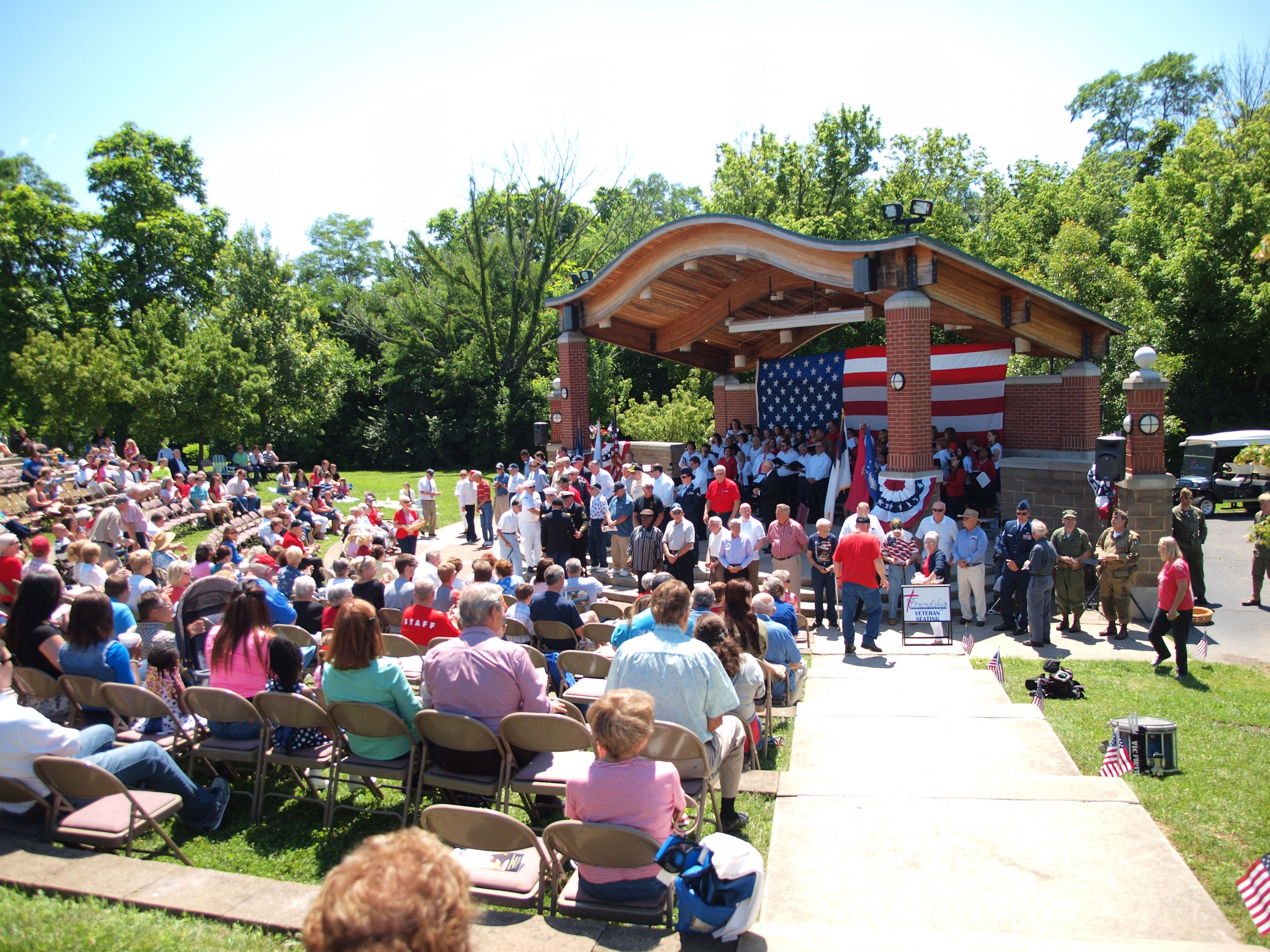 People attend an event at an outdoor amphitheatre