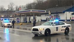 Patrol Cars with Lights on at Gas Station