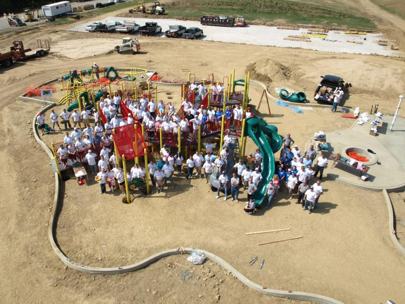 Aerial view of completed playground at Clippard Park with workers