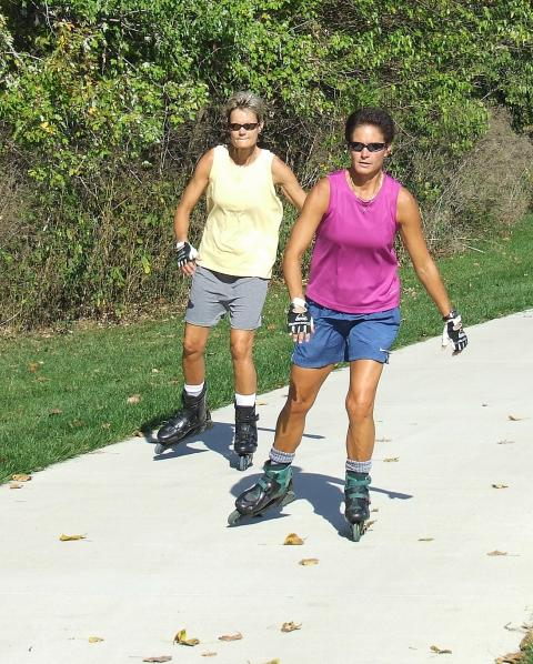 People rollerblading at Heritage Park