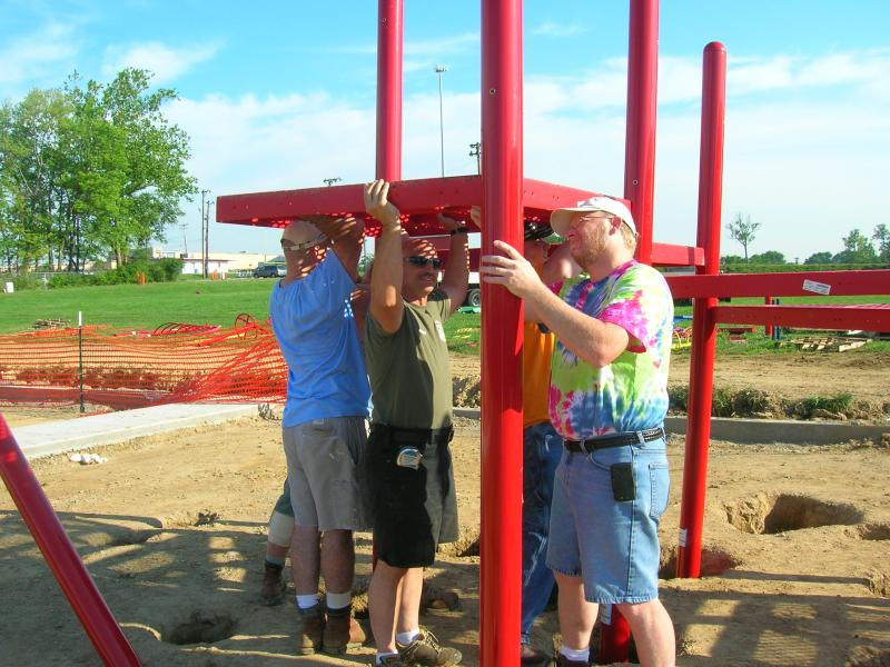 People install support beams for the Groesbeck Park playground